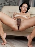Hairy woman Eva's bush spreads outside her panties
