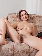 Kittyfall strips naked on her armchair